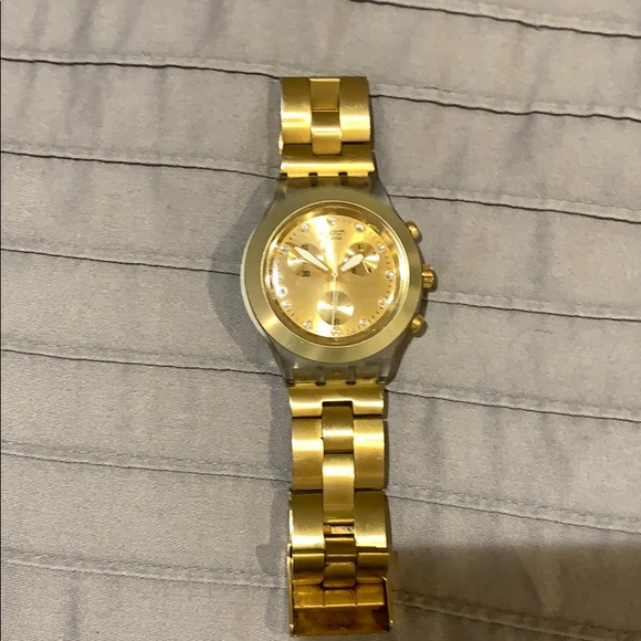Gold Swatch Watch with stones